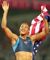 Marion Jones celebrates winning gold in the 200 meters at the 2000 Olympic Games.