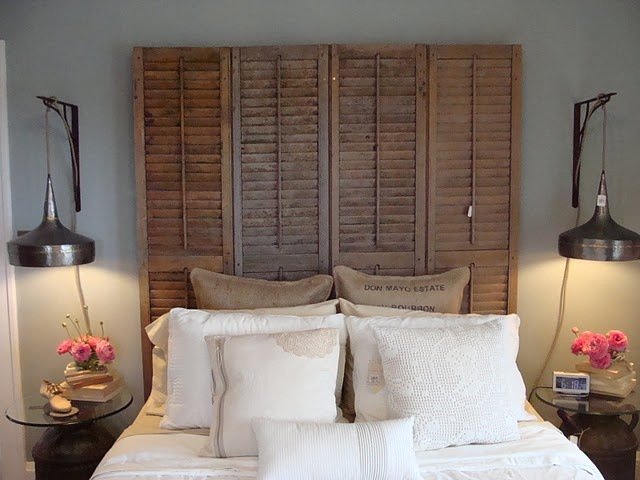 shutters or bifold doors as a headboard - more importantly... love the bedside lighting.
