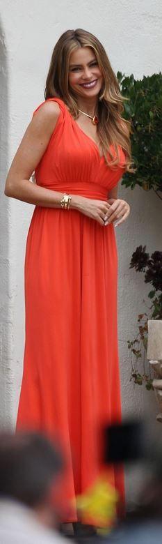 Who made Sofía Vergara's orange maxi dress? Dress – Issa