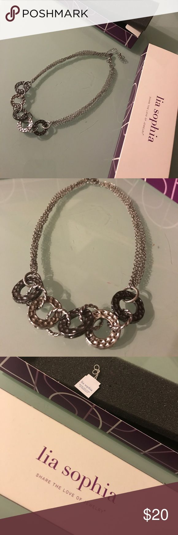 Lia Sophia necklace Beautiful never been worn necklace. Gunmetal and silver. Comes with the box. Perfect condition. Lia Sophia Jewelry Necklaces