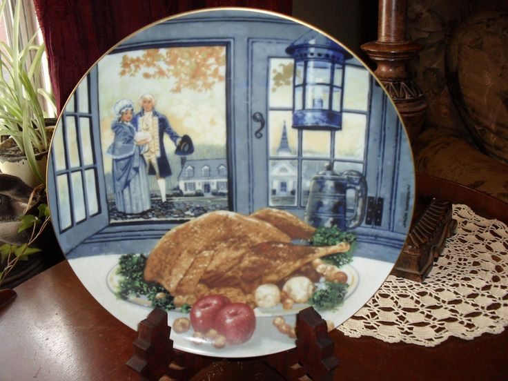 This is The Colonial Thanksgiving plate from the The Thanksgiving Day Plate Collection 1988 Edition with art by Jack Woodson. This is made by the Berne Convention Co. It is in very good condition. It is a 8 5/8 inch plate.