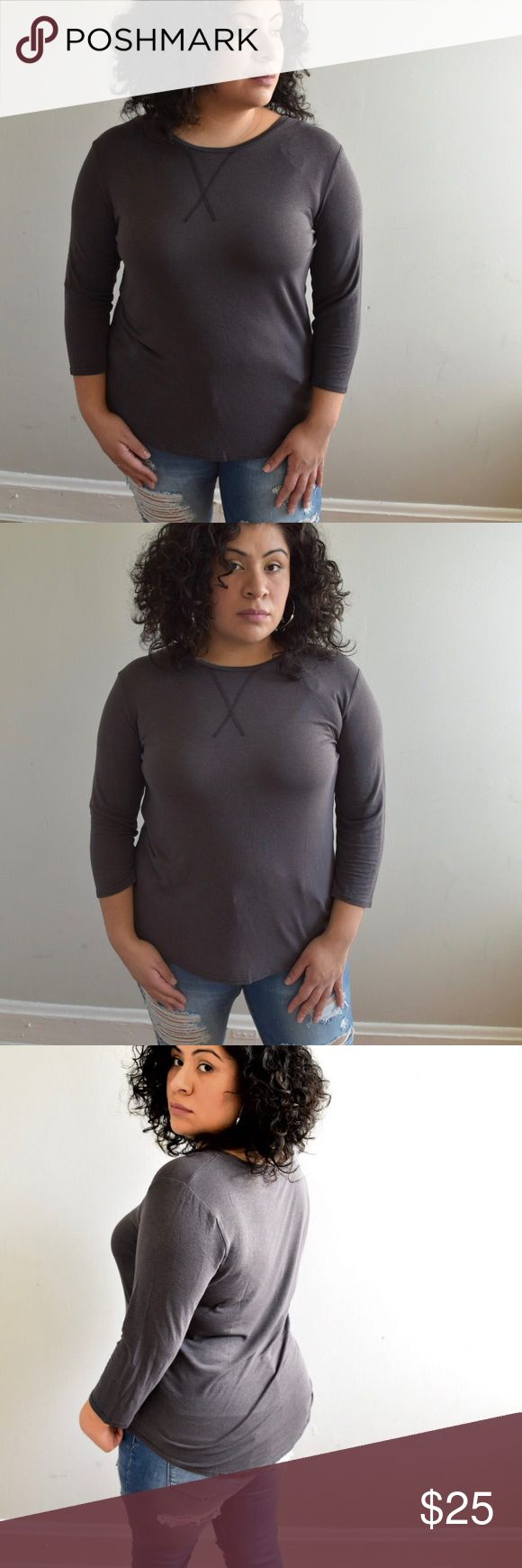"""Charcoal 3/4 Sleeve Top Charcoal Color Top. 3/4"""" sleeves. This is a light fabric, perfect for spring or a cool summer night.  True to size. I am a size 14 modeling size large. Prices are firm unless bundled! Please ask questions if you have any 🤗  Fabric: 65% Cotton 35% Polyester Soft and has some stretch to it. Available in S M L in separate listings.   Measurements: S : Bust 18"""" / Length F 24"""" B 26"""" M : Bust 20"""" / Length F 26 B 28"""" L : Bust 22"""" / Length F 28"""" B 30"""" Onlo Tops"""
