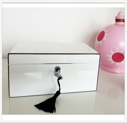 A beautiful musical jewellery box, coated in 7 layers of glossy white lacquer, with silver lock and key, plays a sweet rendition of Clair De Lune  https://soundcloud.com/lumleylocket/clair-de-lune  www.lumleylocket.com