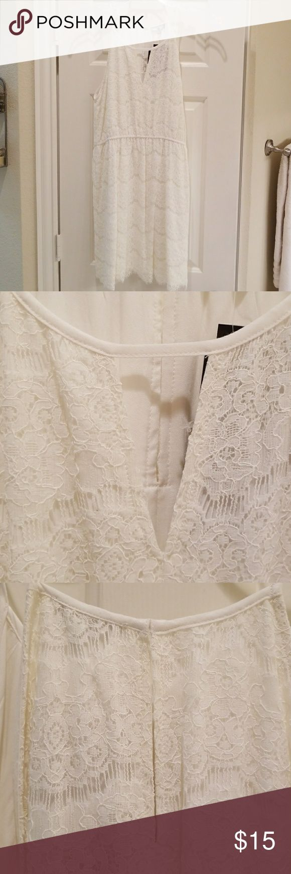 Beautiful white lace dress Delicate white lace spaghetti strap dress, perfect for a wedding or outdoor summer party.  Open V detail in front,  hook -eye closure in back.  Open lace detail at hem.  Light elastic around natural waist. New with tags. 🌹 Diamante Dresses