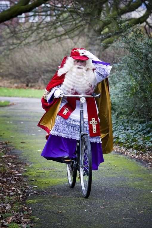 Today the Dutch celebrate 'pakjesavond', the evening when Sinterklaas and Zwarte Piet bring presents to the people. This Sinterklaas changed his mitre for a cap because of today's storm.