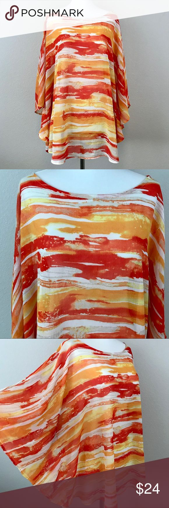 """CHICO's SHEER BATWING TOP - SIZE L/XL Breezy poncho style top in gorgeous orange and yellow hues. Light and bright with so much class! Sides are closed so this is not actually a poncho, but gives a fun effect. Approx. 29"""" long. There is a small run in the fabric, as pictured, which is hard to notice unless up close. Otherwise, great, barely worn condition! Chico's Tops Blouses"""