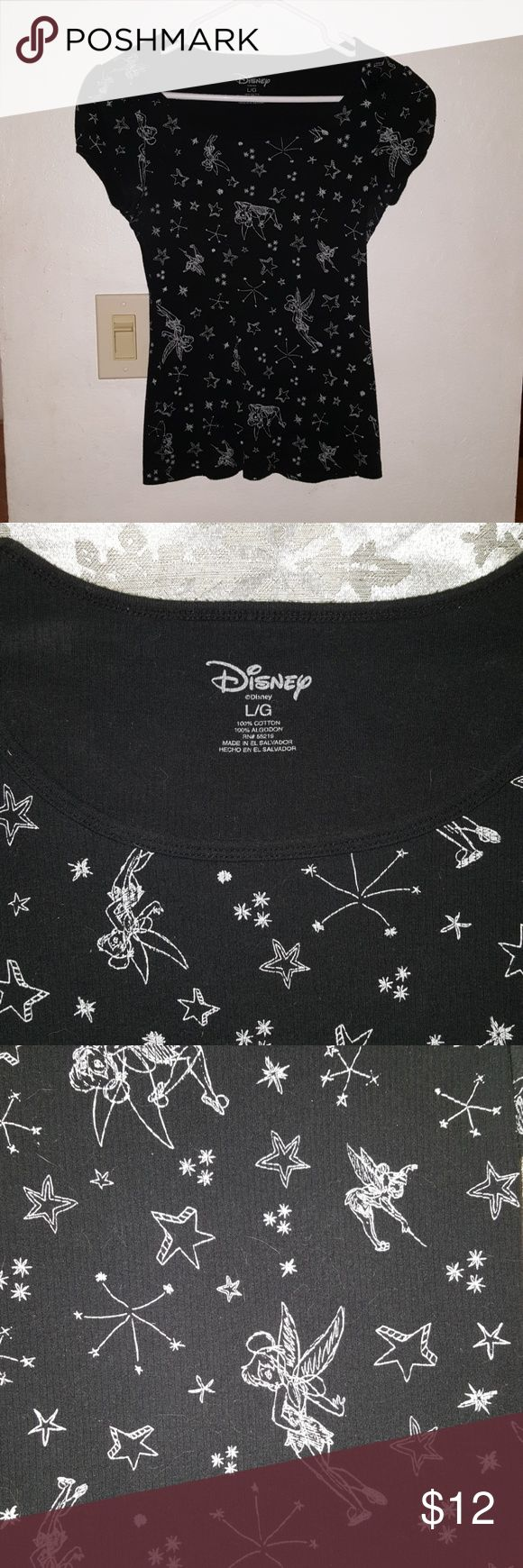 Disney Tinkerbell shirt Really cute Disney shirt . black with Tinkerbell and stars pattern . cap sleeves w/ little star buttons . size large girls but fits like a small in ladies . Used but in good condition . Disney Tops Tees - Short Sleeve