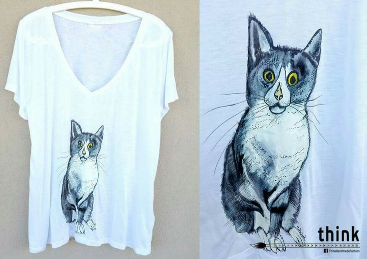 Handpainted cat illustration on woman's t-shirt.