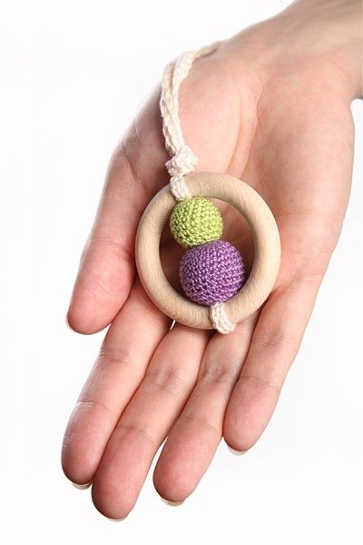 Nursing necklace and teething ring. Baby can play with it while nursing, and chew on it when cruzing around in the baby carrier. Baby approved, and you can choose your own colors!