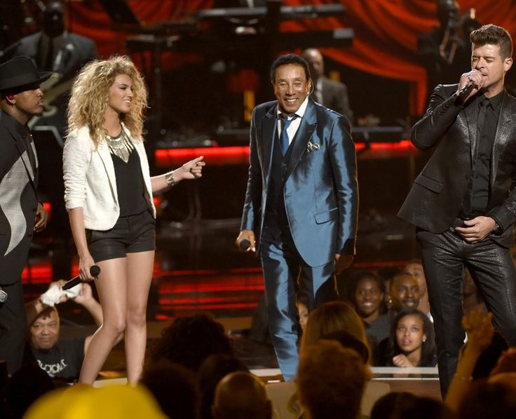 STAR POWER! Ne-Yo, Tori Kelly, Smokey Robinson and Robin Thicke on stage during the show  The four performed together for this year's BET Awards 2015. Picture: PA