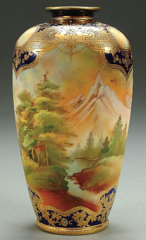 A NIPPON MOUNT FUJI COBALT DECORATED PORCELAIN VASE CIRCA 1900 WITH HAND PAINTED SCENIC DECORATION UNDER A GILT AND COBALT SHOULDER