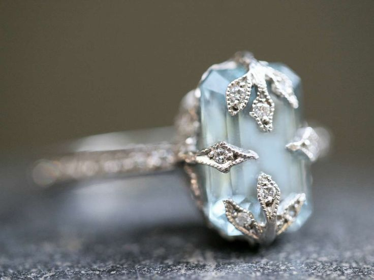 this classic and much coveted cathy waterman ring features an emerald cut aquamarine stone set in diamond studded prongs whose sparkling vines calls to mind - Gemstone Wedding Rings
