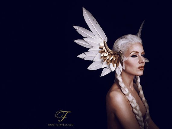 Valkyrie feather headdress. These large Valkyrie wings will definitely turn some heads (even Thor will do a double take!). The headdress is made with
