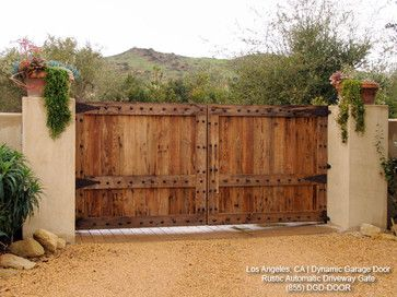 ** garage door style! Tuscan Style Automatic Driveway Gates mediterranean exterior