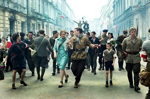 """Miasto 44"", the latest movie by Jan Komasa will be shown in Polish cinemas on 19th September, 2014. It will be a story about youth, love, courage and sacrifice, and it is set during the Warsaw Uprising. For the first time in the history of Polish cinema, the movie's premiere will be preceded by the appearance of a limited collection of t-shirts announcing this production, entitled ""Miasto 44 by QПШ Robert Kupisz""."