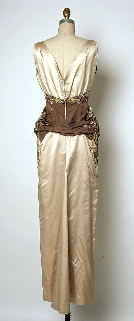 Pierre Balmain evening couture gown Oriane from fall/winter 1954-1955 made from silk satin with embroidered glass bead, shells, pearl and sequin with flower floral embroidery in dual color mermaid style with detachable sash at the back, House of Balmain.