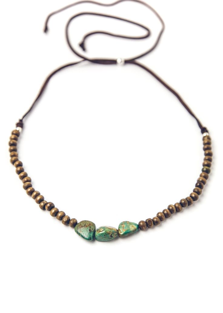 With a traveler's heart, this choker is made with perfectly worn wood beads, featuring a few little nuggets of vibrant turquoise at the center! Beautiful layering piece for all gypsy goddesses!