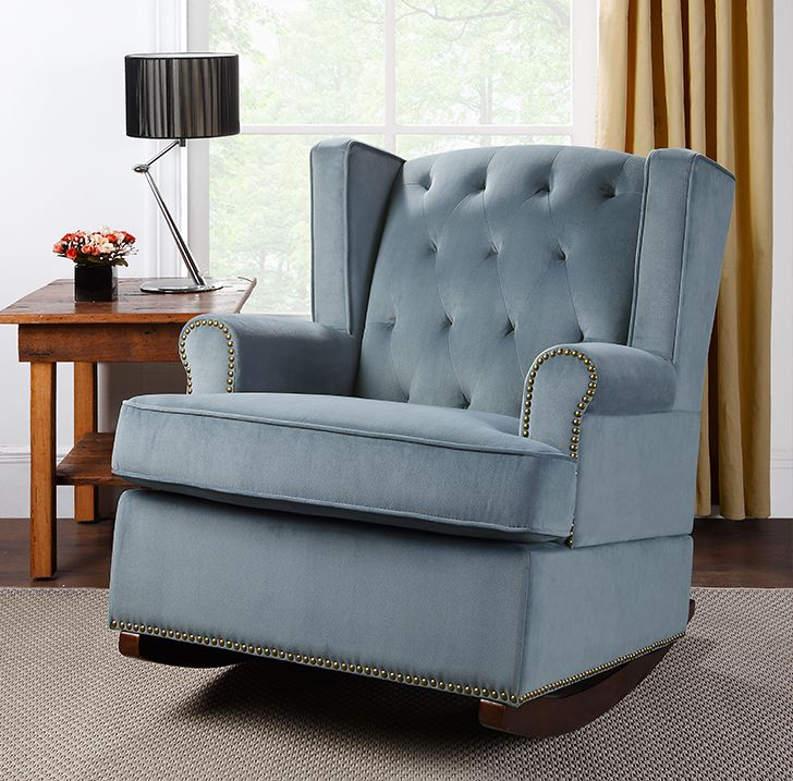 The Nailhead Wingback Rocker in blue offers the utmost in comfort and style. The chair has an air of casual elegance blending a traditional and classic build with a modern wingback design.