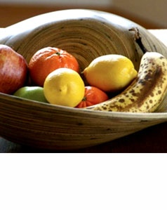 """Be Home, Natural, Raw, Organic:    This curvaceous, natural bamboo fruit bowl is a piece of art unto itself. Filled with fruit or veggies it could model for a lovely, still-life painting. This bowl is reversible and can be used on either side.    Approximately 16"""" in diameter. Due to its artisinal nature, actual size may vary slightly.  Price: $40"""