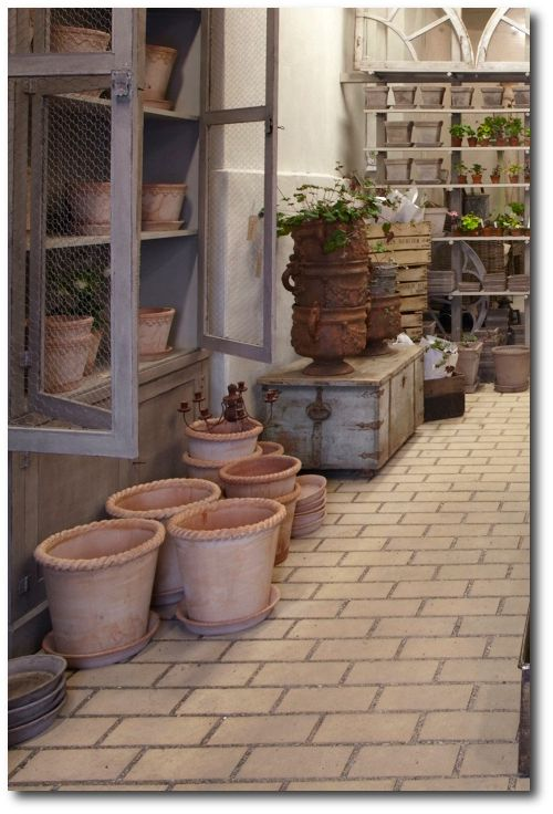 Gustavian Style - Gardening. Pretty gray finish on cupboard and shelves. Swedish Gustavian Decorating