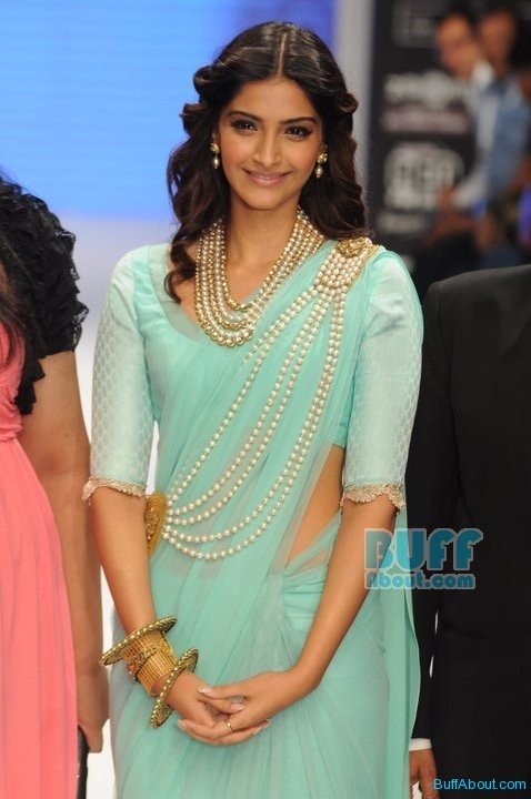 Pinner said: Beautiful Teal Indian Sari Dress and multi-strand pearls necklace