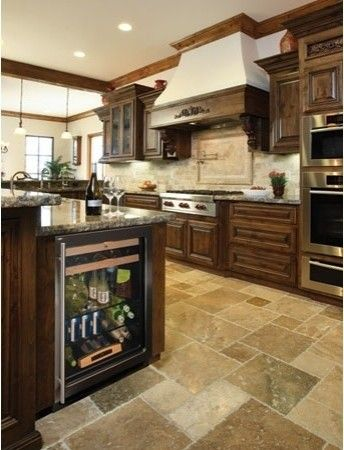 "I like this kitchen but especially the beverage center. While a wine fridge is nice, a beverage center is better for our family since we have more ""other"" stuff than wine and just a couple of bottles of wine in the fridge at a time. P.S. I also think this tile floor is gorgeous!"