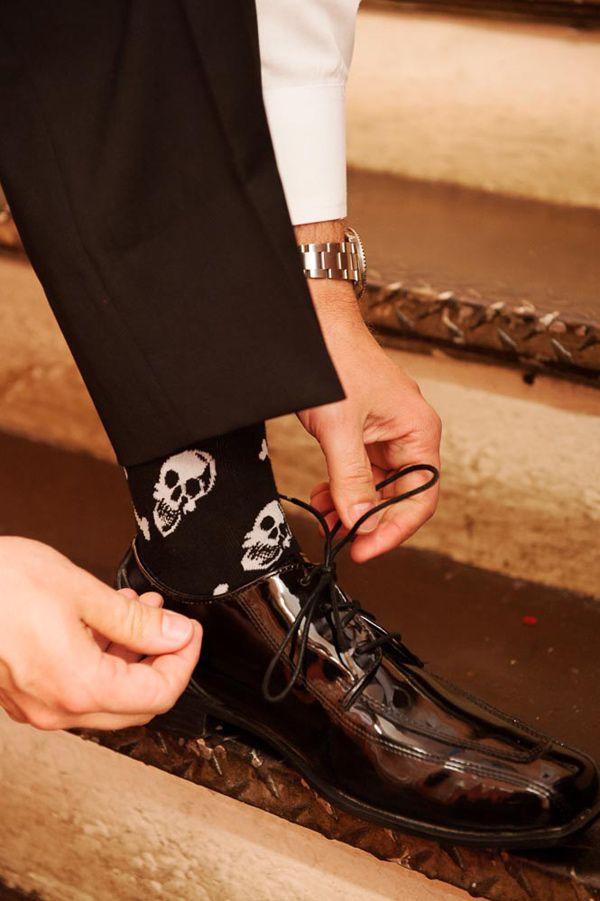 skull socks for a Halloween groom // photo by Photo Pink // http://ruffledblog.com/dracula-inspired-halloween-wedding: