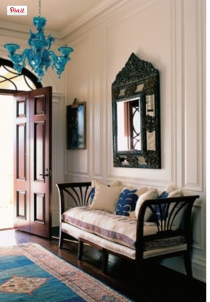 hall entrance furniture. this entrance hall incorporates an italian daybed a dutch mirror persian rug and venetian chandelier all from different time periods furniture r