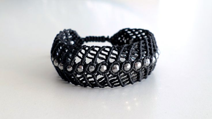 Handmade black macrame bracelet with a series of silver plated Hematite -Price:54€