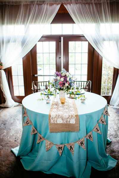 This wedding sweetheart table is covered in burlap table runners and we love everything about it! {Nick & Erin Photography}