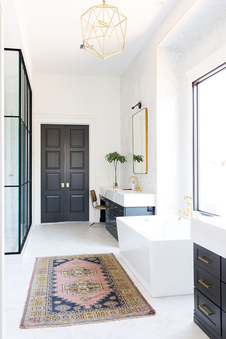 Come check out one of our favorite bathrooms we have designed to date! From the black and gold accents to the finishing details, this is one to remember!