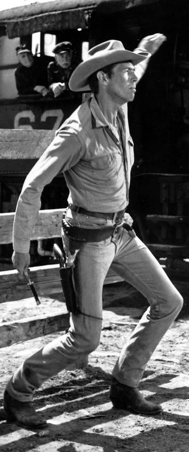 THE MAGNIFICENT SEVEN (1960) - James Coburn uses his knife instead of his six-gun when challenged by Robert J. Wilke - Directed by John Sturges - United Artists - Publicity Still.