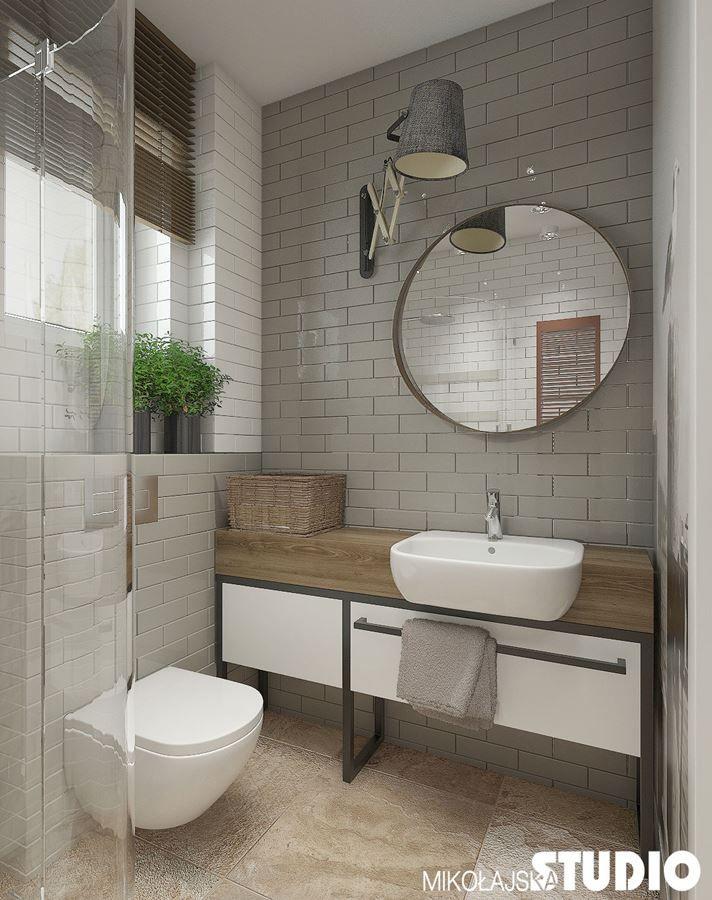 Aranżacja jasnej łazienki z prysznicem w odcieniach szarości. Szara łazienka z prysznicem – inspiracje na wystrój wnętrz. Jak urządzić małą łazienkę.