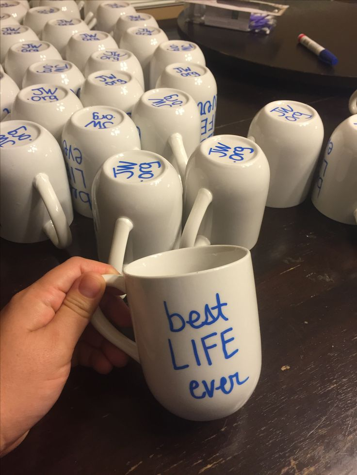 Wrote on mugs with oil sharpie. (Fixed mistakes with nail polish remover) Place in cold oven, as many mugs that can fit on cookie sheet. Turn on oven to 350. Bake for 30 mins. Turn off oven and leave mugs in the oven to cool down till cold.