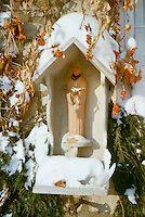 Handmade birdfeeder with St. Francis in bittersweet vine   Mother-Daughter Press