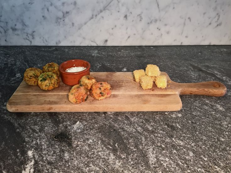 Fritters and Feta! Courgette and feta Fritters, Tomato and feta fritters served with Tzatziki. Alongside sesame coated feta drizzled with Honey!