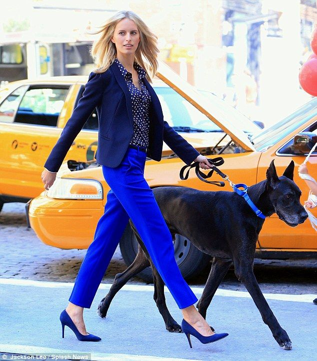 And there she goes: Karolina was the consummate professional as the camera rolled, confidently strutting along the street with the dog in tow