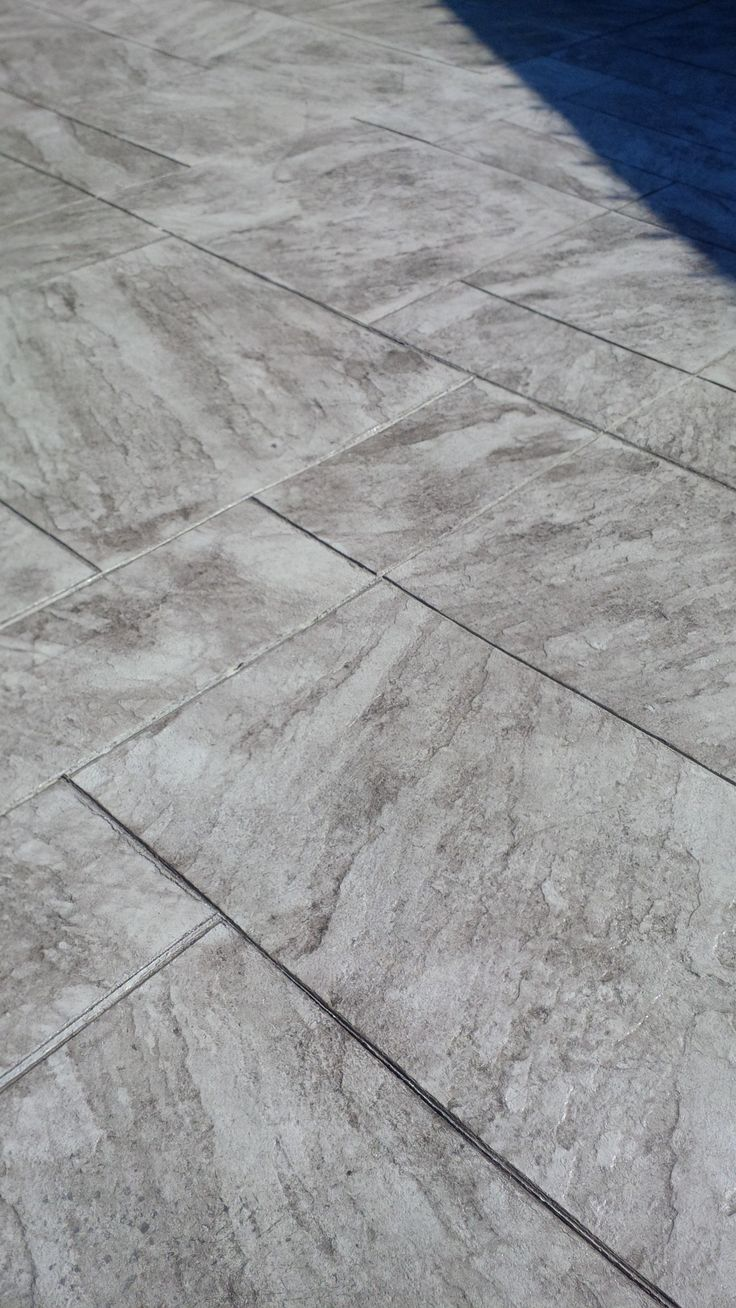 Regular concrete with walnut release agent colour in Pennsylvania stamped pattern.