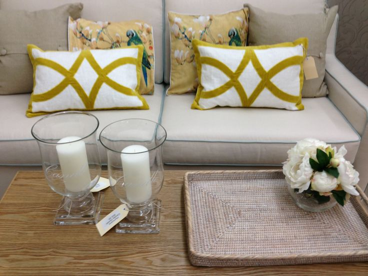 Love these yellow cushions- they add a bit of sunshine to a room...