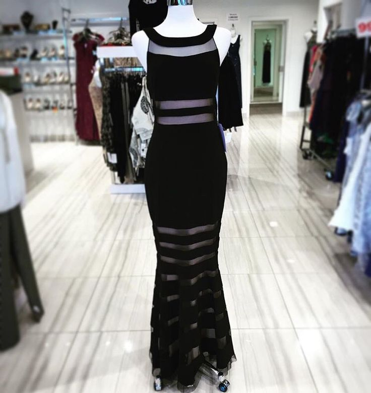 Classic black dress with flattering illusions through out the gown !