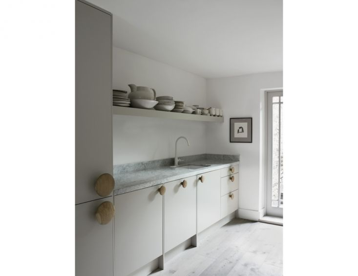 Love the HUGE handles on pantry doors. Mutto Dot Hangers & Muuto-Style Cabinet Pulls - Found on Remodelista