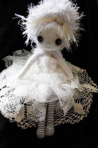 Victorian ghost doll. I love creepy dolls, not zombies though, I love Victorian/Gothic dolls, very cute! This one has a cute poem with it too if you check the original post :)