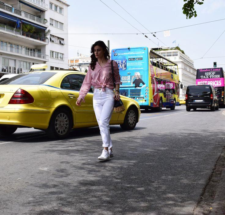 Athens, Greece April 30 white jeans stripes and sneakers  Downtown shoot Instagram @marthakoub