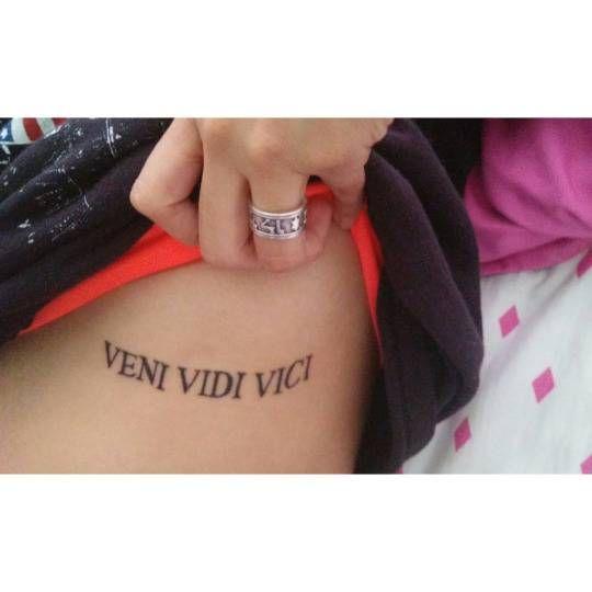 """Side tattoo saying """"Veni vidi vici"""" on Teresa."""