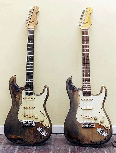 Rory Gallagher's original Stratocaster (left) next to a Fender Custom Shop Rory Gallagher Tribute Stratocaster (right)