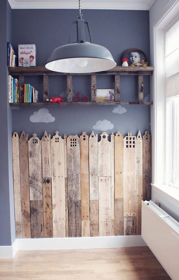 Wooden fence wall decor. I just like this idea, but regular without the houses carved at the top