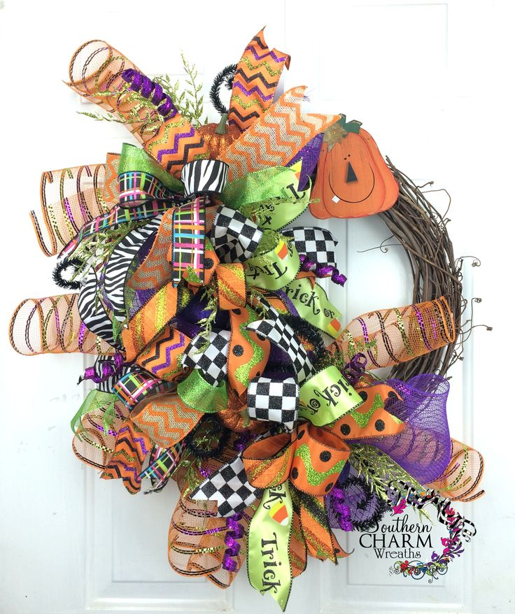 Fun & funky Halloween Deco Mesh Wreath by www.southerncharmwreaths.com. So much fun happening right on your front door! #halloween #wreath