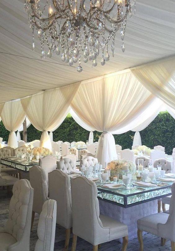 Featured Photographer: Samuel Lippke Studios, Via Revelry Event Designers; Glamorous white outdoor tented wedding reception