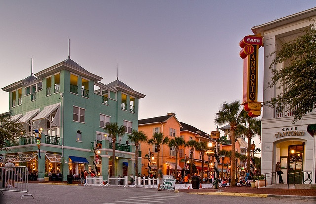 Celebration,Florida - Teeny tiny little town not far from Disney is perfection. They have their own cinema,post office,fishing docks,everything. The colors are beautiful & people drive golf carts on the roads!     by elunandy, via Flickr