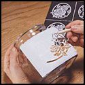 This site allows you to make stencils for glass etching. They also have many different pre-made stencils as well.  LOVE!